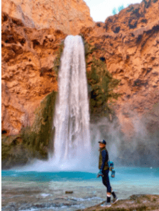 Travel Influencer Lauren Wood in front of a waterfall