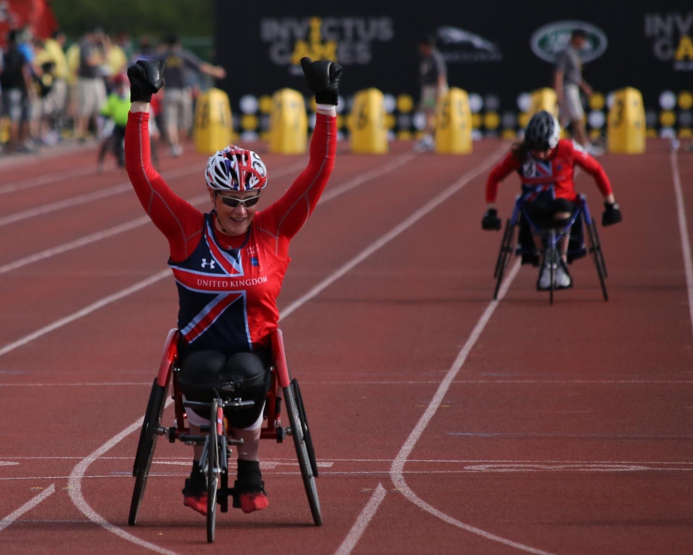 Man on a wheelchair winning a race
